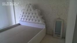 <h5>Detaliu camera</h5><p>Detaliu dormitor cu tapet, mocheta si pat, in timpul lucrului. </p>