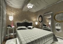 <p>Oglinzile cu rama clasica, patul sculptat si tapetul auriu te poarta intr-un decor aristocrat. </p>