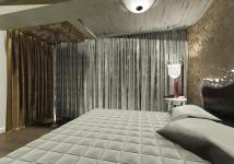 <p>Aceasta camera cu pat s-a dorit sa fie pe nuante de argintiu si auriu, cu bara de dans in colt. </p>