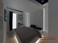 <h5>Lumini in dormitor</h5><p>Dormitorul este ingust insa jocurile de lumini si materialele avantgardiste creaza o atmosfera confortabila.</p>