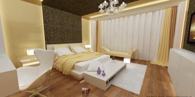 Dormitor matrimonial decorat cu tapet auriu